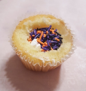 Fill the center of the cupcakes with sprinkles